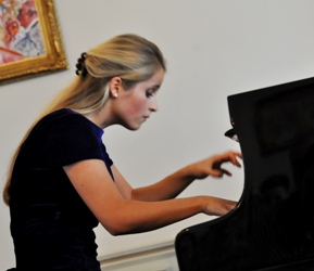 Pianist Georgina Sutton performing in aid of Macmillan Cancer Support UK